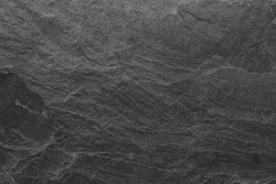 Dark grey black slate background or texture. black stone