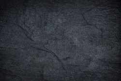 Dark grey black slate stone abstract  background or texture.