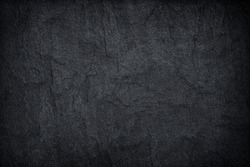 Dark grey black slate stone background or texture