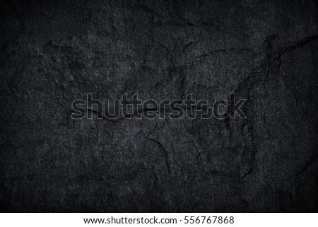 Dark grey black slate stone background or texture. - Shutterstock ID 556767868