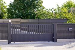 dark grey gate aluminum portal with blades suburbs house street