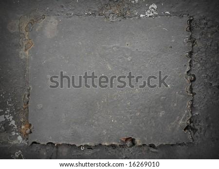 dark grey rusty background, the welded metal plate