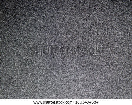 Dark grey textured grainy background Photo stock ©