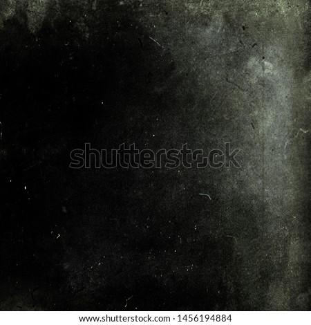 Dark grunge scratched background, old film effect, distressed obsolete dusty movie texture