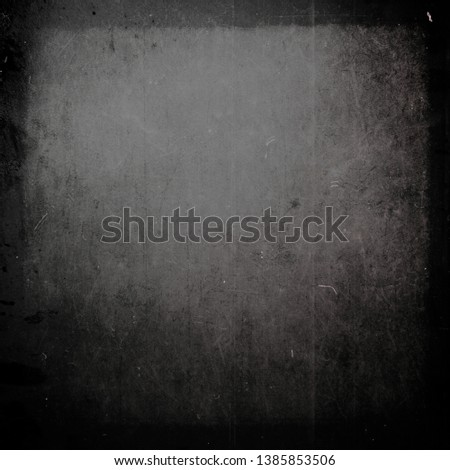 Dark grunge scratched background, old film effect, messy obsolete texture #1385853506