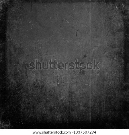 Dark grunge scratched background with frame and space for your text or picture, distressed scary texture