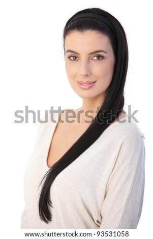 Dark hair beauty posing at camera, smiling.?
