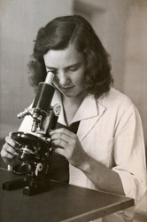 dark hair girl with the microscope - photo scan - about 1955