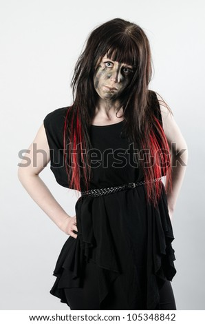 Dark hair with red tips on a young girl wearing a black dress with attitude