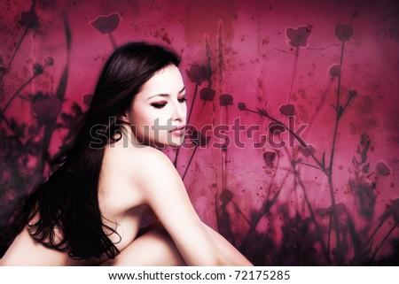 dark hair woman beauty portrait on floral background