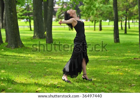 dark haired woman in wooded area