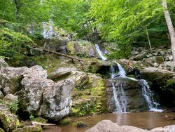 Dark Hallow Falls in Shenandoah National Park. The steep descent following a stream to this beautiful waterfall is one of the Park's most traveled trails. This trail is short, but very steep and rocky