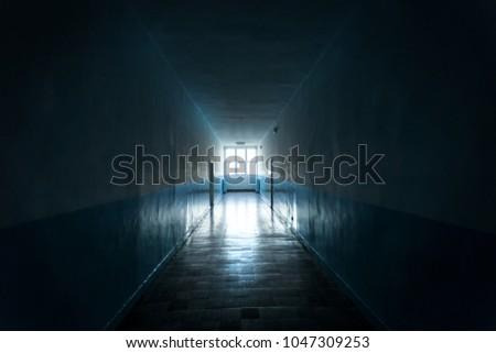 Dark hallway a light at the end #1047309253