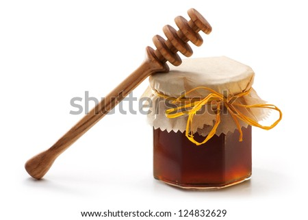 Dark Honey Jar with wooden dipper isolated on white background