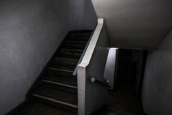 Dark, horrify, scary, old and cramped staircase up and down to mysterious place in the parking lot. Building, abstract, ghost, texture, background, black and white, fearful concept with copy-space.