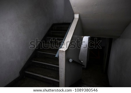 Dark, horrify, scary, old and cramped staircase up and down to mysterious place in the parking lot. Building, abstract, ghost, texture, background, black and white, fearful concept with copy-space. #1089380546