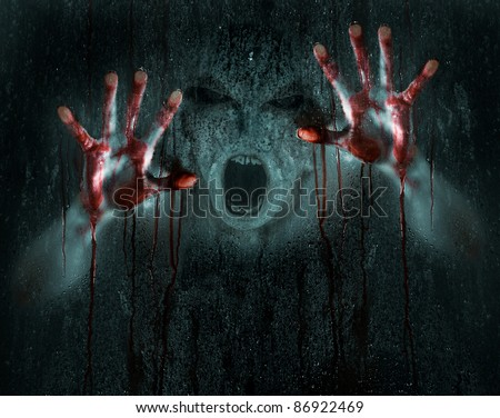 Dark Horror Scene of a Demon or Zombie with Bloody Hands against Icy Wet Glass