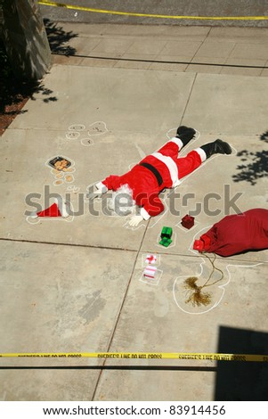 "Dark Humor Series. Santa Claus shot dead in a ""drive by shooting"" . Real Sheriff crime scene tape used in this dramatic scene.  No Santas where harmed in the making of this image series."