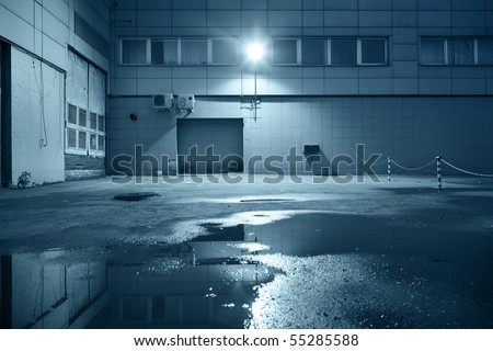 Dark industrial building at night - stock photo