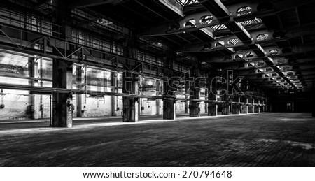dark industrial interior of an...