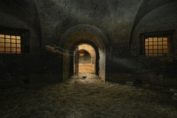 Dark interior of the old abandoned empty underground casemate flank of the Kyiv fortress of the 18th-19th centuries.