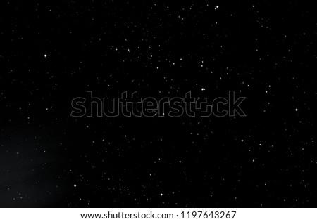 Dark interstellar space. 2d illustration. Stars in a deep space. Blue cold nebula. Dark night sky.