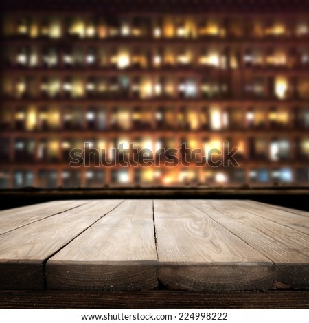 dark landscape of city in night and table of wood  #224998222