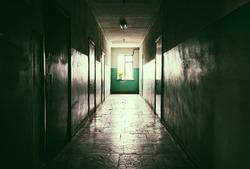 Dark long corridor with doors