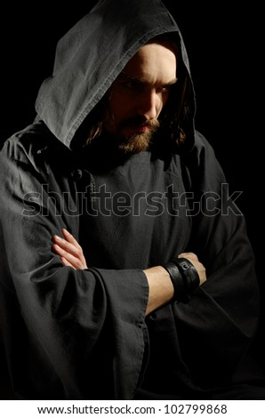 dark medieval monk over black background