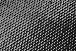 Dark metallic ellipse pattern texture background.