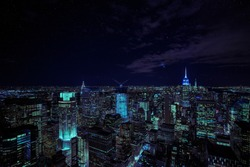 Dark Mode Neon Cityscape at Night with Starry Sky Background and vibrant lights