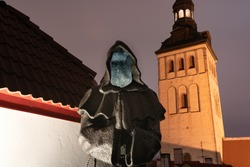 Dark monk sculpture located in Tallinn's medieval town. Spooky looking hallow shady monk. Dark times after halloween and before Christmas.  Grim reaper looking sculpture - fit for corona autumn