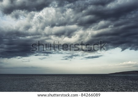 Dark moody sky over the gray sea.