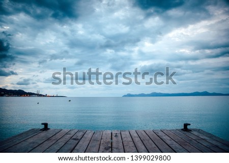 Dark morning by the sea. Pier in storm. Solitude, Loneliness concept photo #1399029800