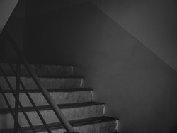 Dark mysterious cement stairs in lonely quiet building on black and white style. horror landscape concept.