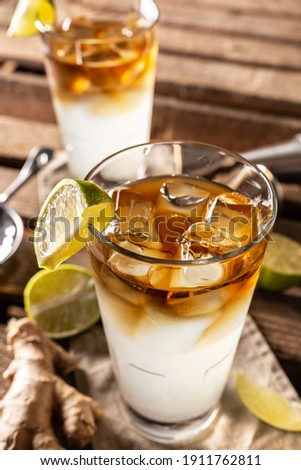 Dark n Stormy highball cocktail served as a long drink with rum, fresh lime juice, and ginger beer. Stok fotoğraf ©