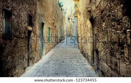Dark narrow street with  in the city Valetta on the island of Malta