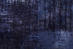 Dark navy blue and denim fluffy background of soft, fleecy fabric. Texture of indigo velveteen textile backdrop with shiny pattern, closeup.