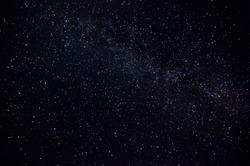 Dark night sky Milky Way and stars on a dark background. Starry sky over Chelyabinsk region, Russia
