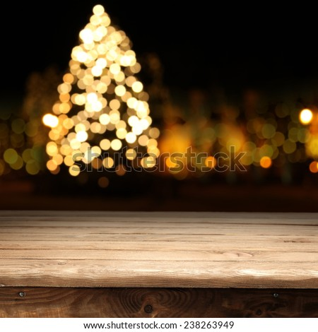 dark night xmas tree and wooden table place
