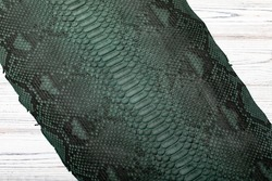 Dark olive-green dyed python leather with snake black print