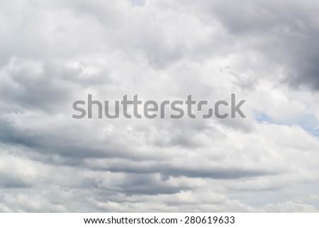Dark ominous gray storm clouds. Dramatic sky.