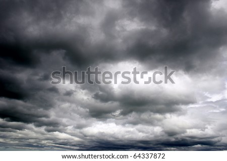 Dark ominous grey storm clouds. Dramatic sky. #64337872