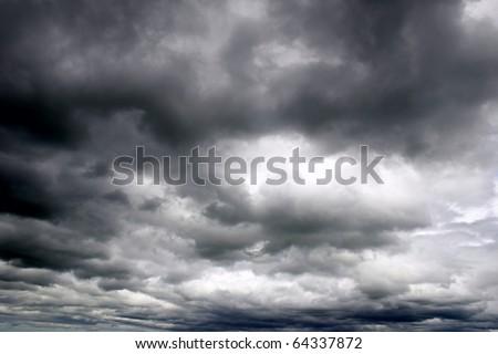 Dark ominous grey storm clouds. Dramatic sky. Сток-фото ©