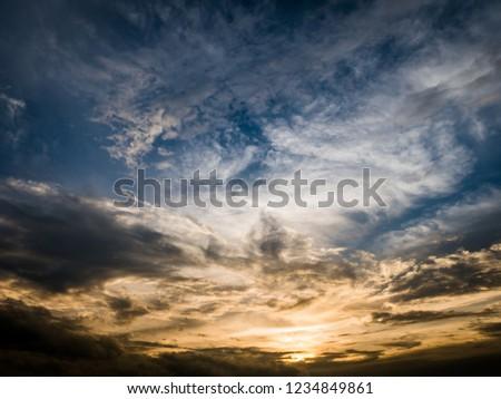 Dark orange and blue dramatic cloudy sky background