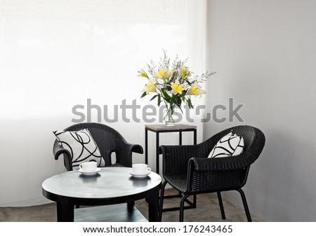Dark outdoor furniture in a bright setting
