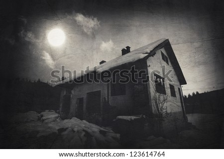 dark over the spooky old house - textured vintage background