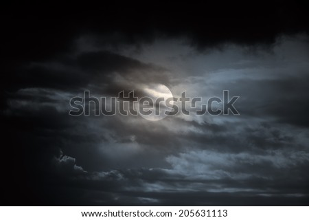 Dark overcast full moon night