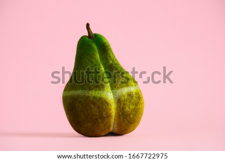 dark overexposed pear with traces of sunburn, creative concept summer vacation sunburn Stockfoto ©