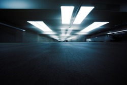 Dark parking garage industrial room interior. Zoom blur perspective.